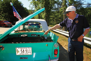 bob stover points to the engine, which is under the car's rear hood   louvers on the hood angle in different directions to protect the engine  when the car is